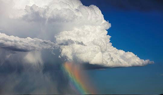 Cumulonimbus clouds with rainbow